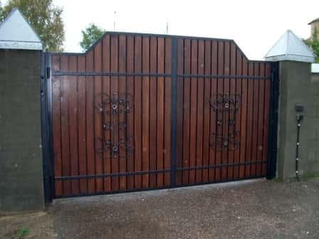 Распашные и откатные садовые ворота – надежная защита вашего участка