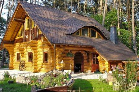 Дома из оцилиндрованного бревна - фото